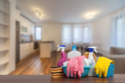 Home cleaning service concept with supplies.